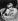 """Brian Jones (1942-1969), musicien anglais et guitariste des Rolling Stones, lisant un exemplaire du journal """"Bild"""" lors d'une tournée à Hambourg (Allemagne), 13 septembre 1965.  © C.T. Fotostudio / Ullstein Bild / Roger-Viollet"""