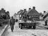 World War II. Normandy landings. US soldiers entering Montebourg (France), on June 21, 1944. © Roger-Viollet