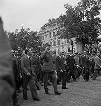 World War II. Liberation of Paris. Victory parade. French General Charles de Gaulle, Georges Bidault and Alexandre Parodi, French politicians, going down the Champs-Elysées. Paris (VIIIth arrondissement), on August 26, 1944. Photograph by Jean Roubier (1896-1981). © Fonds Jean Roubier/Roger-Vio