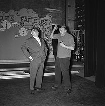 """Jacques Tati (1907-1982), French actor and director, and Bruno Coquatrix (1910-1979), French theatre manager, during rehearsals of """"Jour de fête"""". Paris, Olympia, April 1961. © Jean-Régis Roustan / Roger-Viollet"""