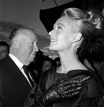"Alfred Hitchcock (1899-1980), American director, and Tippi Hedren (born in 1930), American actress, attending the presentation of the film ""The Birds"" at the Cannes FIlm Festival (France), 1963.  © Roger-Viollet"