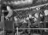Albert Einstein, assistant à une conférence dans l'Albert Hall, avec dans la tribune Lord Rutherford et Sir Austen Chamberlain. Londres (Angleterre), 1933. © Imagno / Roger-Viollet