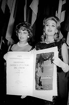 "Melina Mercouri (on the right, 1925-1994), Greek actress and politician, presenting her Best Actress Award diploma for her role in ""Never on Sunday"" and Jeanne Moreau, Best Actress Award for her role in ""Moderato cantabile"". Cannes Film Festival, 1960. © Roger-Viollet"