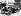 Henry Ford, avec son fils Edsel, au volant de la 20 millionième voiture sortie de son usine de Détroit. © TopFoto / Roger-Viollet