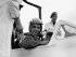 Le roi Hussein de Jordanie (1935-1999) dans le cockpit d'un De Havilland Vampire T.11, avion à réaction de la Royal Air Force, avant de se rendre en Grande-Bretagne pour une visite officielle, 21 juin 1955. © PA Archive/Roger-Viollet