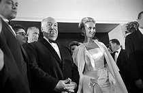 "Alfred Hitchcock (1899-1980), American director, and Tippi Hedren (born in 1930), American actress, attending the presentation of the film ""The Birds"" at the Cannes FIlm Festival (France), 1963. © Noa / Roger-Viollet"