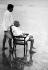 Mahatma Gandhi (1869-1948), homme politique indien, et son fils, Devdas sur la plage de Bombay (Inde), 1944.  © TopFoto/Roger-Viollet
