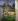 """Paul Cézanne (1839-1906). """"Cour de ferme à Auvers"""". Paris, musée d'Orsay.  © Roger-Viollet"""