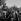 World War II. Liberation of Paris. Parisians on a tank from the 2nd Armored Division commanded by General Leclerc, place de l'Hôtel de Ville, August 25, 1944. © Pierre Jahan/Roger-Viollet