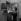 Vie familiale ouvrière. Le père règle le poste de radio. Paris, 1952. © Jacques Rouchon / Roger-Viollet