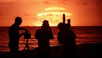 Photographers and cameramen photographing and filming a mushroom cloud created during Operation Koa. Bikini and Enawetak atolls (Marshall Islands), on May 12, 1958. © Bilderwelt / Roger-Viollet