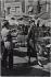 Through the streets of Paris. Jacky (Audrey Hepburn's double), Givenchy model, in Montmartre, place du Tertre. Paris (XVIIIth arrondissement), 1956. Photograph by Jean Marquis (born in 1926). Bibliothèque historique de la Ville de Paris. © Jean Marquis / BHVP / Roger-Viollet