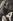Jeune femme posant en maillot de bain et tenant une ombrelle. France, 1925-1930. © Alinari/Roger-Viollet