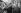 Clients d'un stand de bouquiniste. Paris, printemps 1964. Photographie d'Harold Chapman (né en 1927). © Harold Chapman / TopFoto / Roger-Viollet