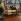 Vitrine de magasin animée - famille attablée dans une salle à manger. Vers 1960-1965. © Roger-Viollet
