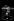 """Reportage sur les Folies Bergère. La danseuse Véronica Bell dans la """"cage d'amour"""" lors de la représentation de """"Une vraie folie"""". Photographie de Jacques Rouchon (1924-1981). Paris, 1952. © Jacques Rouchon / Roger-Viollet"""