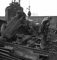 """World War II. German occupation. Destruction of statues in order to recycle the metals. Paris, 1941. At the bottom : """"Le Gué"""", by Lefevre, once situated in the Buttes-Chaumont park and on top, from left to right, the statue of Charles Floquet, French politician, by Jean-Bernard Descomps (1872-1948) and the monument to the sergeant Bobillot, by Auguste Paris (1850-1915). Paris, 1941. © Pierre Jahan / Roger-Viollet"""