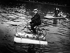 Homme traversant la Seine sur son vélo aquatique. France, 1910. © Maurice-Louis Branger / Roger-Viollet