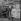 """Une de """"France-Soir"""" à l'entrée de la station de métro Saint-Lazare annonçant le premier vol spatial par le cosmonaute russe Iouri Gagarine. Paris, 12 avril 1961.      © Roger-Viollet"""