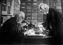 The brothers Auguste (1862-1954) and Louis Lumière (1864-1948), pioneers of cinema, in their laboratory, 1927.  © Jacques Boyer / Roger-Viollet