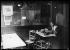 """Mère Rosalie"" peeling vegetables in her restaurant where artists of the Montparnasse district used to gather. Paris, around 1920. © Albert Harlingue / Roger-Viollet"