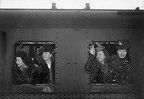 "Viviane Romance, Danielle Darrieux, Suzy Delair and Junie Astor, leaving for the presentation in Berlin of ""Premier rendez-vous"", film by Henri Decoin. Paris, Gare de l'Est train station, March 1942. © LAPI/Roger-Viollet"