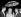 """De gauche à droite : Jacques Demy et Catherine Deneuve après avoir remporté la Palme d'or du Festival de Cannes pour """"Les Parapluies de Cherbourg"""", 15 mai 1964. © TopFoto/Roger-Viollet"""