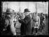 """Au camp de Brou, le 5 mars 1919 : """"M. Poincaré remet la fourragère jaune au fanion de son ancien bataillon"""", le 11ème bataillon de chasseurs alpins. Photographie parue dans le journal """"Excelsior"""" du jeudi 6 mars 1919. © Excelsior – L'Equipe/Roger-Viollet"""
