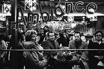 """Atmosphere"". New Year's Eve dinner at Pigalle. Paris (IXth arrondissement), 1970's. © Jean-Pierre Couderc / Roger-Viollet"