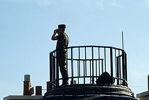 Opening of the Opéra Bastille. Serviceman on a roof. Paris, on July 13, 1989. © Colette Masson/Roger-Viollet