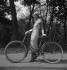 Elegance contest on bicycle at the Bois de Boulogne. Paris (XVIth arrondissement), May 1933. © Boris Lipnitzki/Roger-Viollet