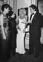 Mrs Grès (1903-1993), French fashion designer, with Mireille Darc (1938-2017) and Alain Delon, French actors. © Jack Nisberg / Roger-Viollet