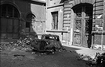 World War II. Liberation of Paris. German car damaged by the French Forces of the Interior, near the rue de Rivoli. Paris (Ist arrondissement), on August 25, 1944. Photograph by Jean Roubier (1896-1981). © Fonds Jean Roubier/Roger-Vio