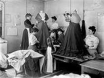 Putting on the finishing touches at the atelier of the great Parisian designer Worth. Paris 1907. © Jacques Boyer/Roger-Viollet