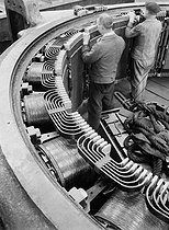 Sources of energy. Alsthom company : Frame of the motor of a rolling machine. Belfort (France), 1931-1934. Photograph by François Kollar (1904-1979). Paris, Bibliothèque Forney. © François Kollar/Bibliothèque Forney/Roger-Viollet