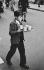 Young boy delivering some tea. London (England), 1958. © Jean Mounicq/Roger-Viollet