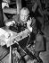 """Alfred Hitchcock au téléphone lors du tournage de son film """"Le Crime était presque parfait"""". Etats-Unis, 1954.        © TopFoto / Roger-Viollet"""