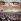 Leipzig (Allemagne). VIIIème fête du sport au stade central. Au centre, les fédérations sportives. Dans les gradins, 12.000 participants formant l'emblème de la RDA à l'aide de drapeaux de couleurs. 1987. Photo : Ernst-Ludwig Bach. © Ullstein Bild / Roger-Viollet