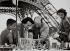 Man selling miniatures of the Eiffel Tower. Paris, 1950s. Photograph by Janine Niepce (1921-2007). © Janine Niepce / Roger-Viollet