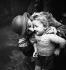 Miners. Miner kissing his child. Waziers (France). Compagnie des mines d'Aniche. 1931. Photograph by François Kollar (1904-1979). Paris, Bibliothèque Forney. © François Kollar/Bibliothèque Forney/Roger-Viollet