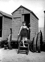 Swimmer going out of her beach hut, around 1910. © Neurdein/Roger-Viollet