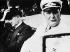 """Après la signature des accords de Munich. Edouard Daladier (1884-1974), Premier ministre français, et Hermann Goering (1893-1946), maréchal du Reich, en route pour l'hôtel """"Vier Jahreszeiten"""". Munich (Allemagne), 30 septembre 1938. © Ullstein Bild / Roger-Viollet"""