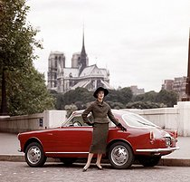 Model wearing an outfit made by Pierre Balmain (1914-1982) and posing next to an Alfa Romeo Giulietta Sprint. Paris, circa 1955. Photograph by Jacques Rouchon (1924-1981). © Jacques Rouchon / Roger-Viollet