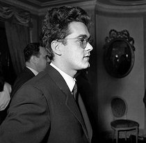 Michel Legrand (1932-2019), French singer-songwriter and composer, attending a reception honouring Maurice Chevalier (1888-1972), French actor and singer, 1959. © Roger-Viollet