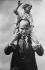 Benito Mussolini (1883-1945), Italian statesman, with his son. © Roger-Viollet