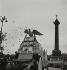 Parade at the place de la Bastille. Truck of the left-party magazines. Paris, 1950. Photograph by Janine Niepce (1921-2007). © Janine Niepce/Roger-Viollet