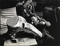 Metal polisher working on a sculpture by Jean-Robert Ipousteguy (1920-2006), French painter and sculptor. Paris (XXth arrondissement), rue des Pavillons, 1969. Photograph by Léon Claude Vénézia (1941-2013). © Léon Claude Vénézia/Roger-Viollet