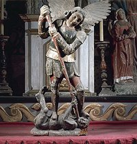 """Saint Michael flooring the dragon"". Wood, polychrome. Church of Fridefont (Cantal). © Roger-Viollet"