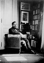Claude Debussy (1862-1918), French composer, in his study, 1910. © Roger-Viollet