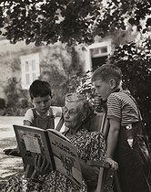 Two fans of Tintin with their grandmother. Rully (France), 1952. Photograph by Janine Niepce (1921-2007). © Janine Niepce/Roger-Viollet